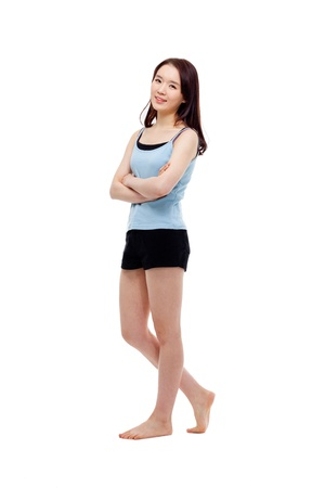 teen girl: Young Asian woman full shot isolated on white background. Stock Photo