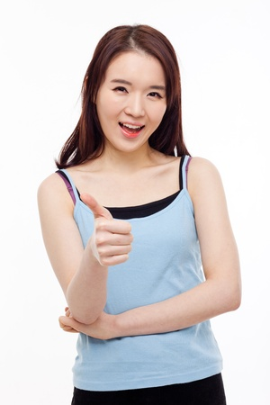 Young Asian woman showing thumb isolated on white background. photo