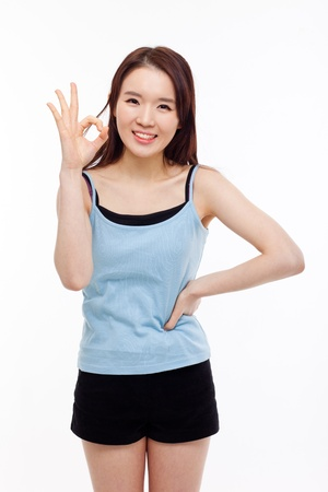 Cute woman with okay hand gesture isolated on white background.  photo