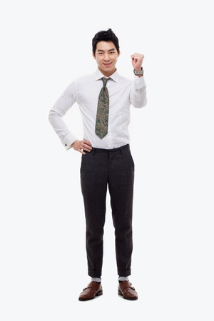 Showing fist young Asian business man isolated on white background. Stock Photo - 17662303