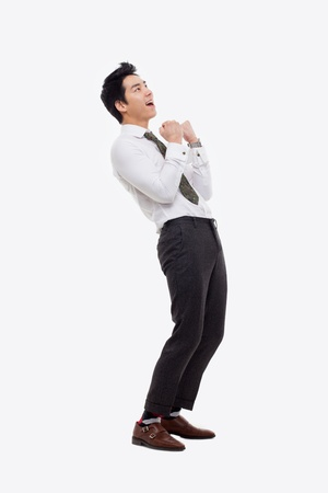 Showing fist young Asian business man isolated on white background.