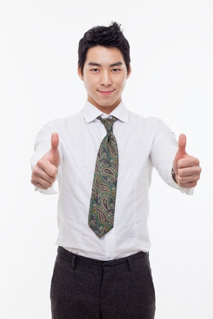 good job: Showing thumb young Asian business man isolated on white background.