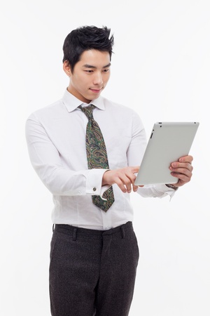 Young Asian man using a pad PC isolated on white background   Stock Photo