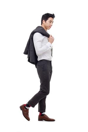 Jonge Aziatische zakenman geïsoleerd op een witte achtergrond.