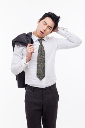 A tired Asian business man isolated on white background. Stock Photo - 17662354