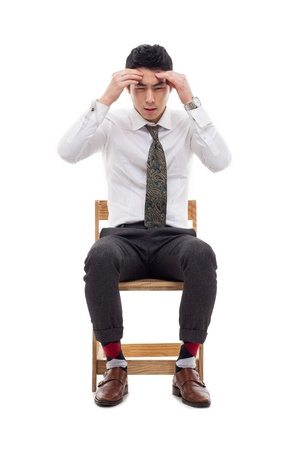 tired businessman: Young Asian man having a stress on isolated on white background.