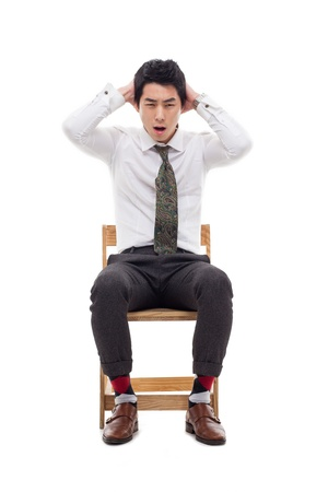 Young Asian man having a stress on isolated on white background.