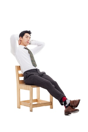 Young Asian business man sitting on the chair and fall a sleep  isolated on white background. photo
