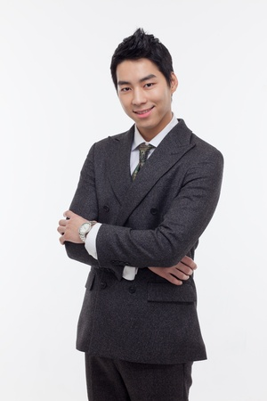 Asian young business man isolated on white background. photo