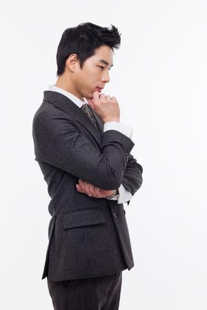 Thinking businessman isolated on white background. Stockfoto