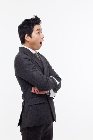 Asian young business man surprized isolated on white background.