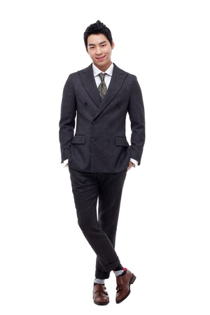 full suit: Young Asian business man isolated on white background.