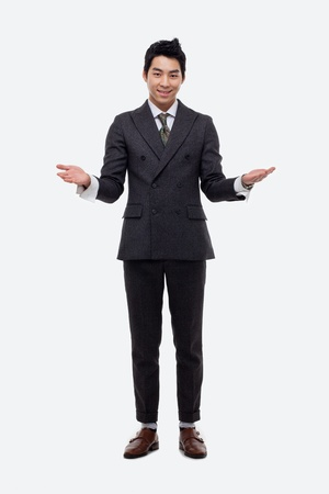 welcom: Young Asian business man showing welcom sign isolated on white background.