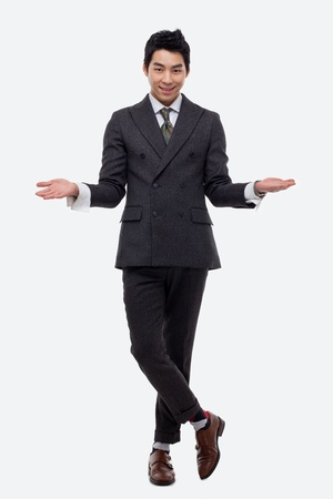 Young Asian business man showing welcom sign isolated on white background. photo