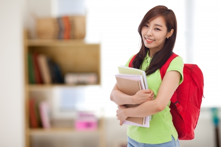 Young pretty Asian student indoors shot. Stock Photo