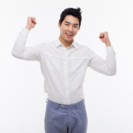 Young Asian man showing fist and happy sign isolated on white background.