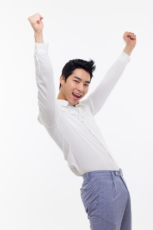 Young Asian man showing fist and happy sign isolated on white background.  photo
