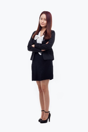 Yong pretty Asian business woman isolated on white background.  Stock Photo
