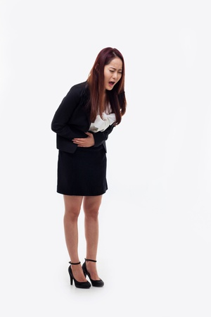 cramp: Young Asian businesswoman having a cramps isolated on white background.