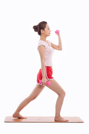 female muscle: Young Asian woman  exercise with dubbbell isolated on white background.