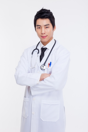 Young Asian doctor isolated on white background