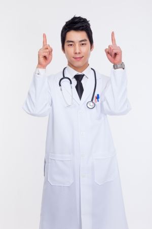 asian doctor: Young Asian doctor indicate upside isolated on white background.