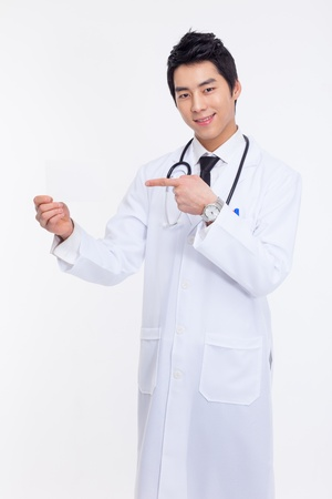 Young Asian doctor showing card isolated on white background. photo
