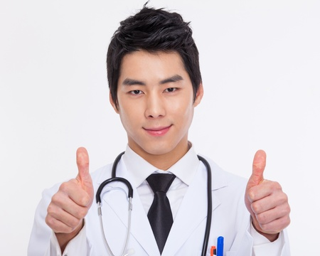 studio happy overall: Young Asian doctor close up shot isolate on white background.