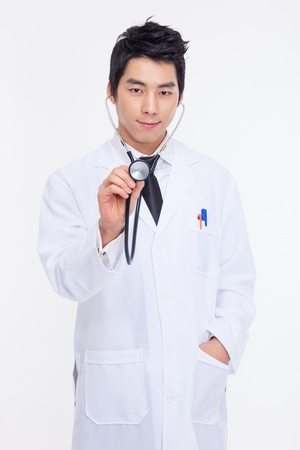 doctors tools: Young Asian doctor using stethoscope isolated on white background.