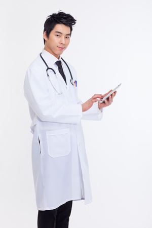 lab tech: Young Asian doctor using tabet pc isolated on white background  Stock Photo