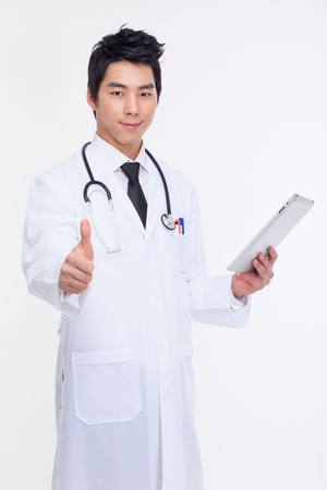 Young Asian doctor using tabet pc isolated on white background  photo