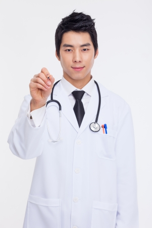 doctor writing: Young Asian doctor using pen isolated on white background   Stock Photo