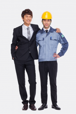 arms around: Asian Business man and engineer put arms around each others shoulders.