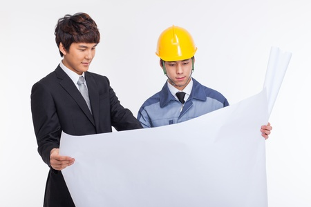hat project: Asian business man and engineer having a blueprint isolated on white.