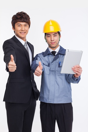Asian business man and engineer have a pad PC isolated on white photo