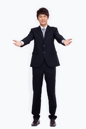 asian businessman: Young Asian business man showing welcom sign isolated on white background.