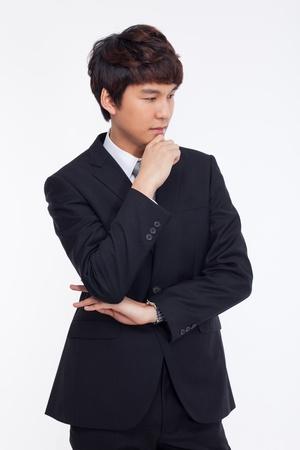 Thinking businessman isolated on white background. photo