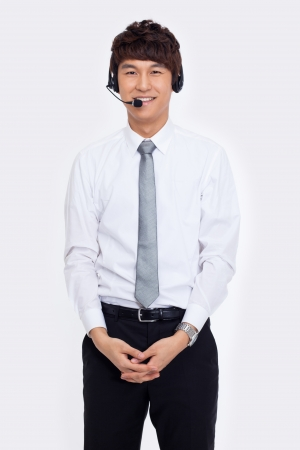 Asian business customer support operator man smiling isolated on white background.  photo
