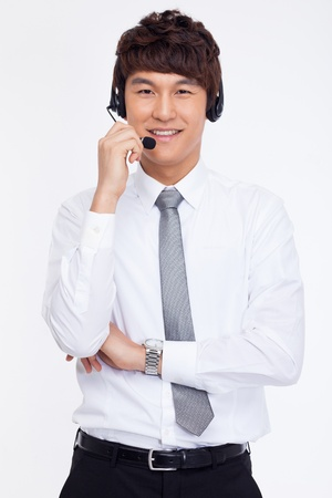 Asian business customer support operator man smiling isolated on white background. Stock Photo - 18471629