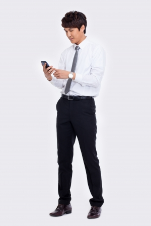 Asian business man with cellphone isolated on white background. Stockfoto