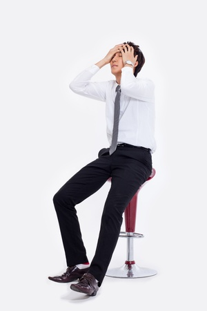 executive chair: Young Asian man having a stress on isolated on white background.