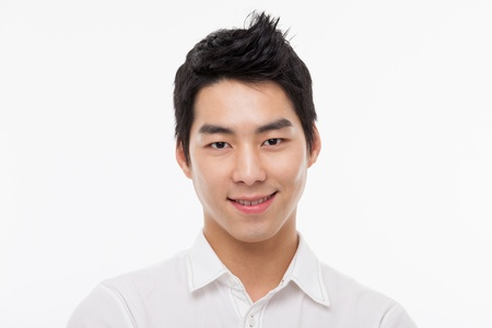 asian teenager: Young Asian man close up shot isolated on white  Stock Photo