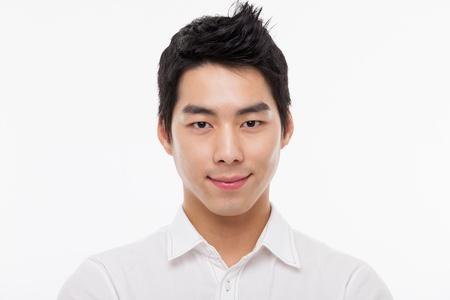 man close up: Giovane uomo asiatico colpo da vicino isolato su bianco Archivio Fotografico