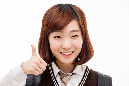 best schools: Young Asian student closeup shot isolated on white background. Stock Photo