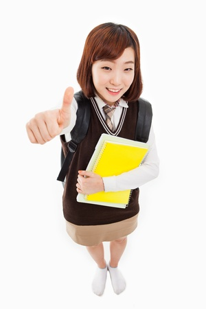 high angle shot: Young Asian student shwoing thumbs and high angle shot  isolated on white background. Stock Photo