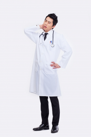 Young Asian doctor having a stress isolated on white background. photo