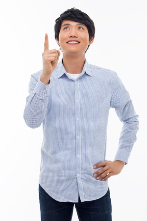 Young asian man indicated upside isolated on white background.  photo
