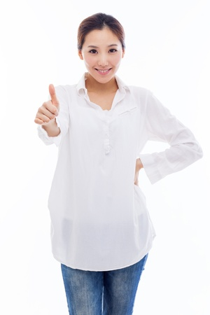 thumbs up woman: Young Asian woman showing thumb isolated on white background. Stock Photo
