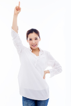 woman pointing up: Smiling young woman pointing upwards isolated on white background.