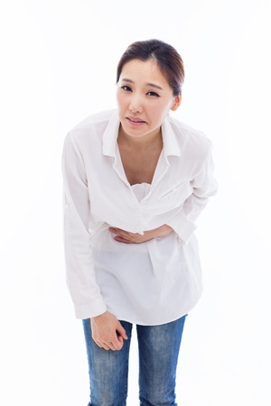 Young Asian woman having a stomachache isolated on white background.